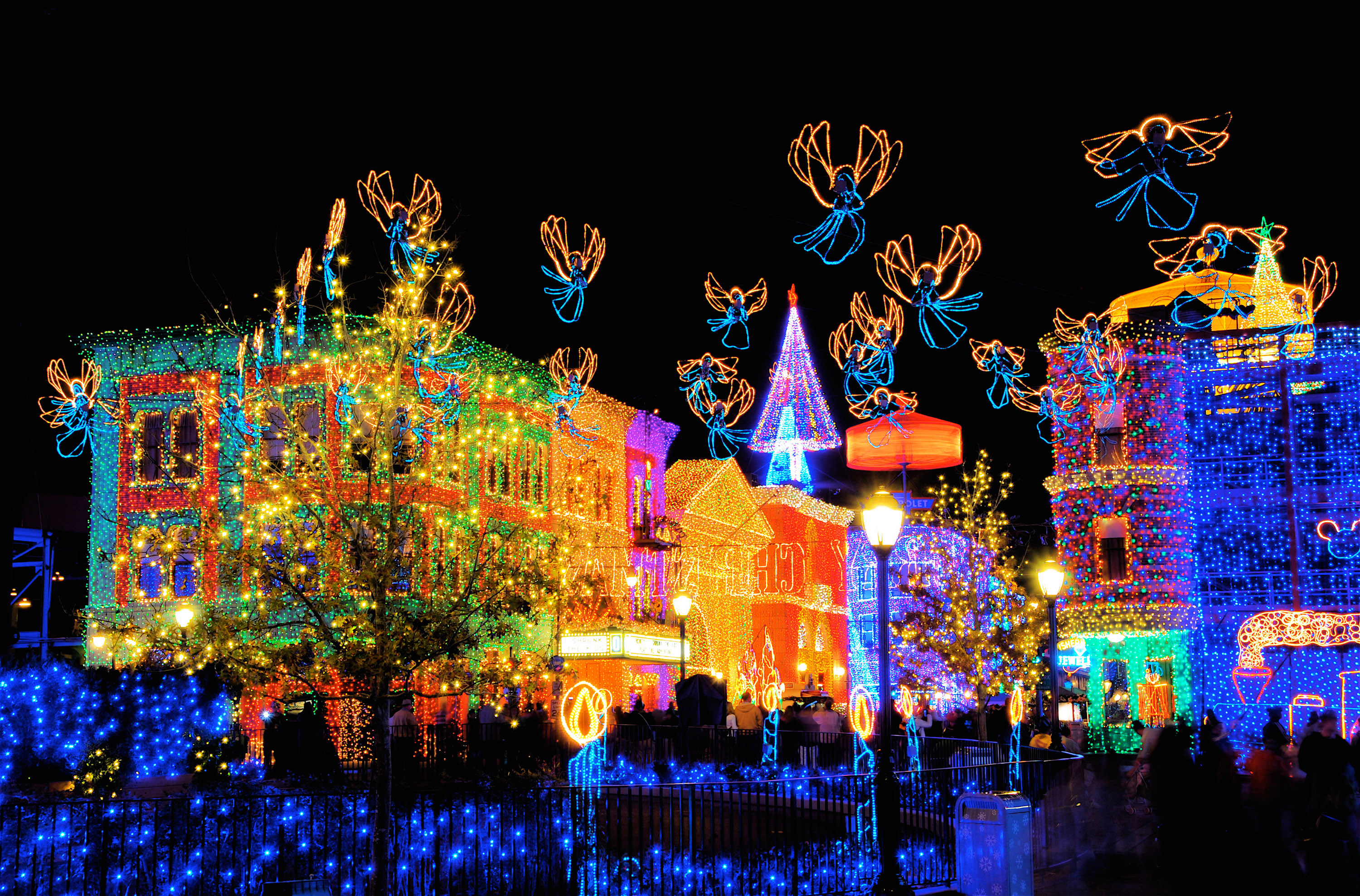 each evening millions of twinkling bulbs are used to create a dazzling spectacle of christmas joy almost every surface is covered in twinkling lights and - Hollywood Studios Christmas Lights