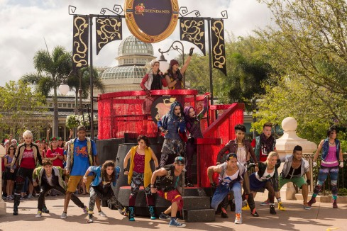 (Nov. 10, 2015) The cast of Disney Channel Original Movie 'Descendants' (On float: Cameron Boyce who plays Carlos (top left), Booboo Stewart who plays Jay (top right), Sofia Carson who plays Evie (bottom left) and Dove Cameron who plays Mal (bottom right)) perform Nov. 10, 2015 during the taping of the 'Disney Parks Unforgettable Christmas Celebration' TV special in Magic Kingdom park at Walt Disney World Resort in Lake Buena Vista, Fla. The 32nd annual holiday telecast airs nationwide Dec. 25 on ABC-TV. (Mariah Wild, photographer)